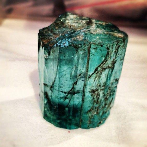 Emerald gemstone, beautiful and green with black flecks